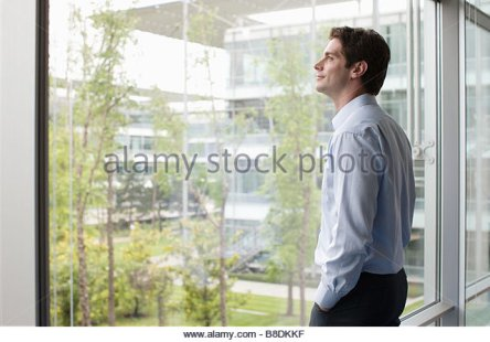 man-looking-through-window-b8dkkf